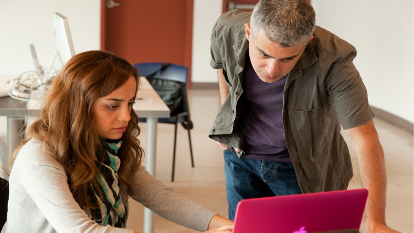 Interaction Design Certificate instructor George Papazian works with a current s