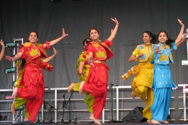 Female bhangra performers on stage