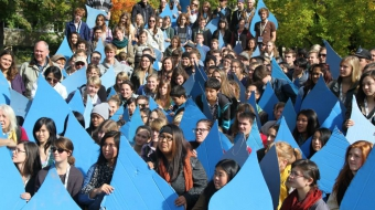 Power Shift participants hold up water drops as part of a youth eco-conference.