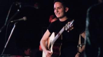 Artist Evan Ivan and his acoustic guitar